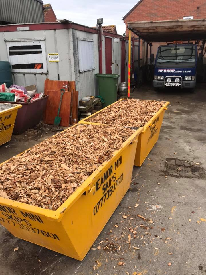 Two mini skips loaded with bark chippings