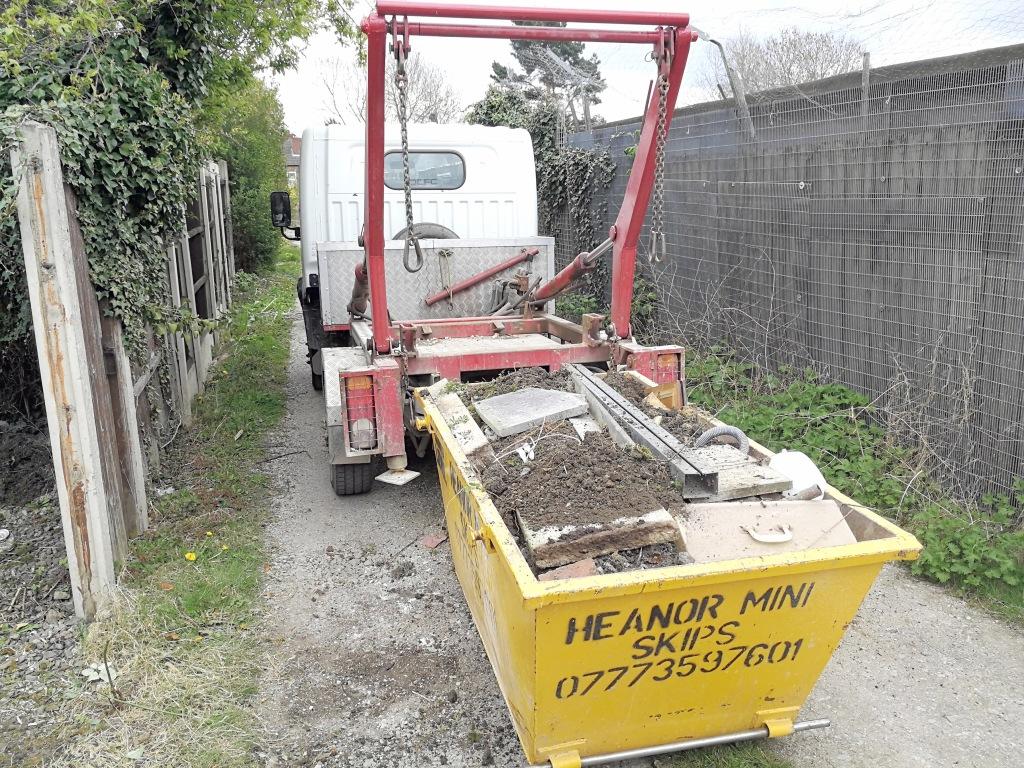 A Heanor mini skips lorry down a thin alley