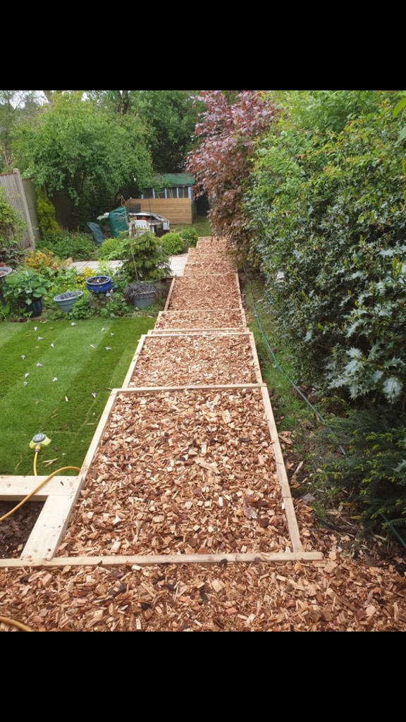 Steps in a garden using bark chippings